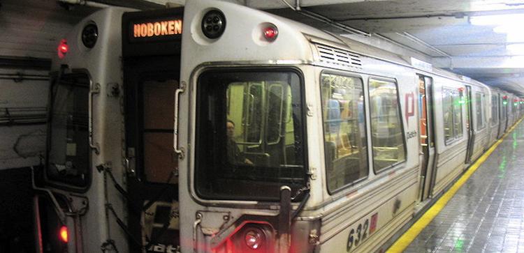 idiot rides outside subway car