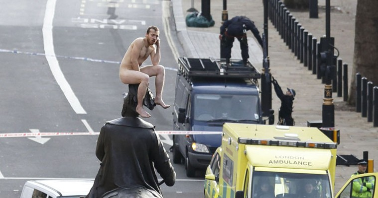 Naked Man Perched On The Duke Of Cambridge
