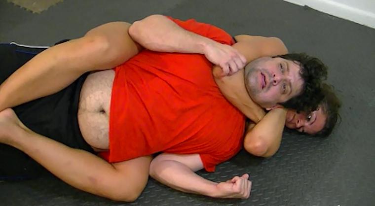 guy rear naked choke on girl