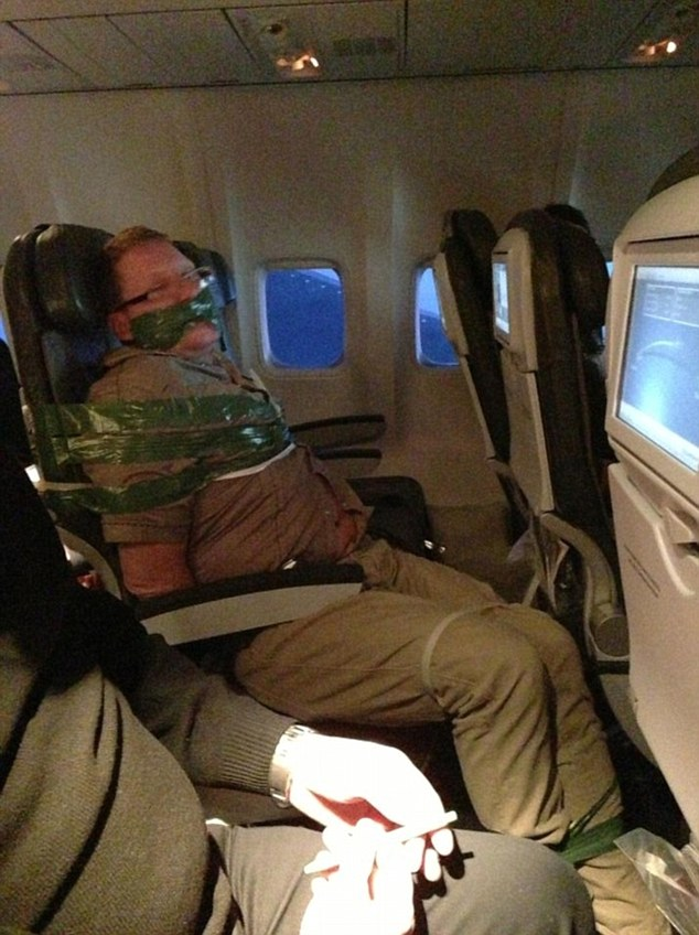 Drunk Passenger Taped To Seat