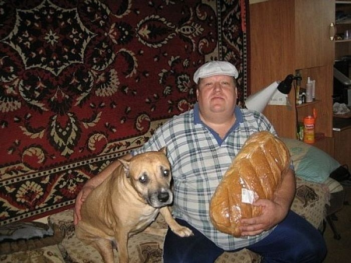 Hilarious Russian Photos - Big Man, Big Bread, Worried Dog