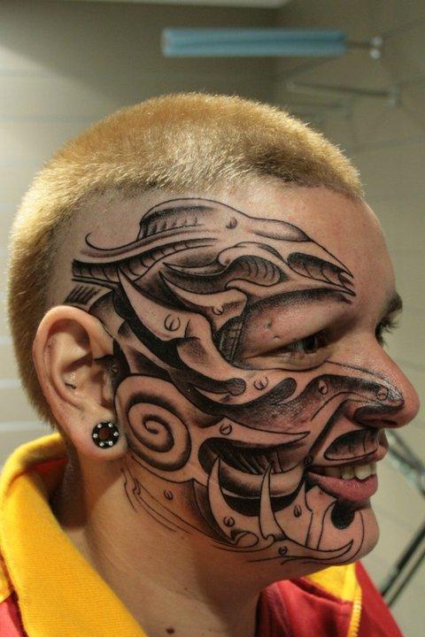 Rouslan Tomumaniantz - Tattoo Face Biomechanical