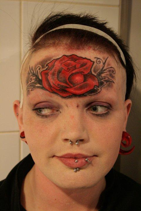 Rouslan Tomumaniantz - Tattoo Face Rose