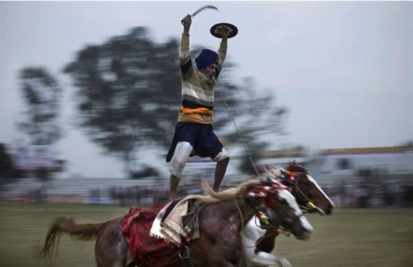 Rural Olympics Man riding two horses