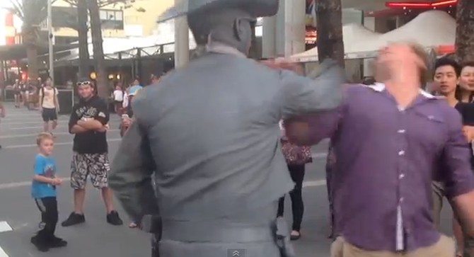 Street Performer Punches Man