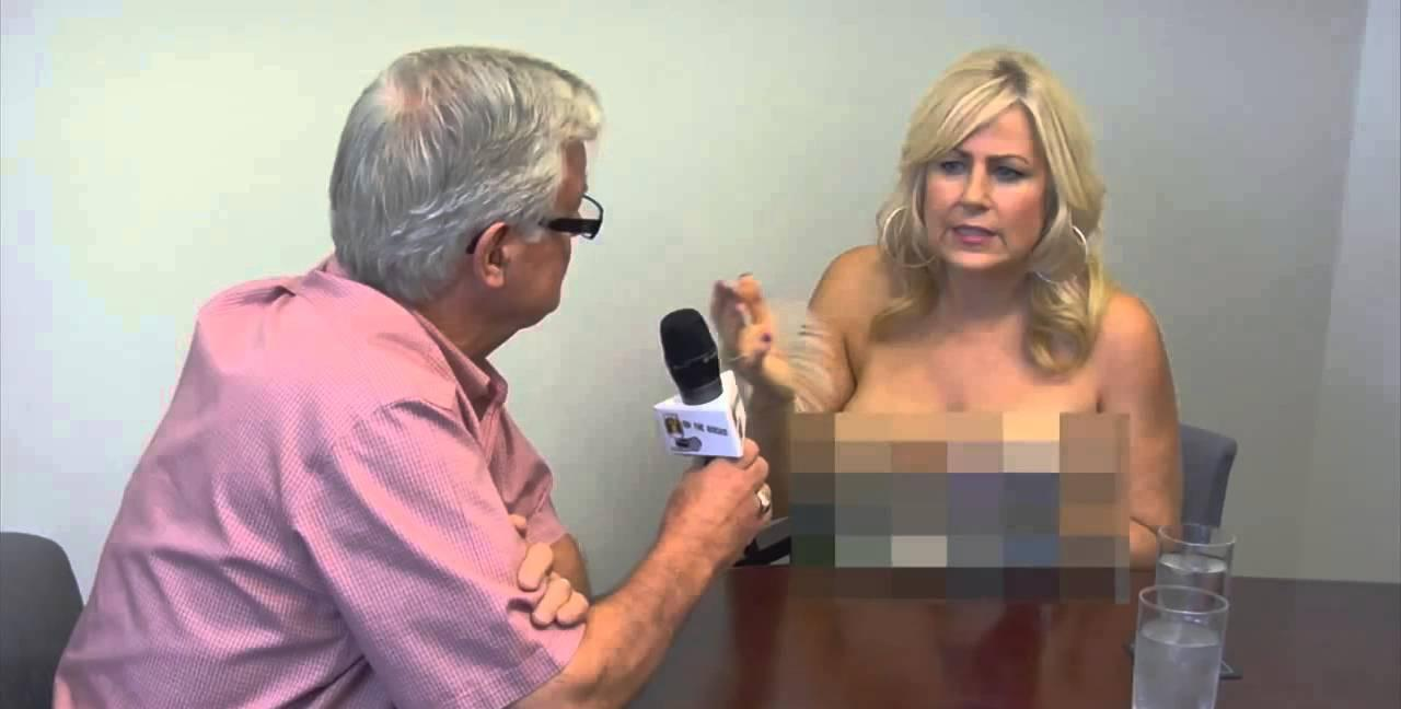 Journalist flashes breasts