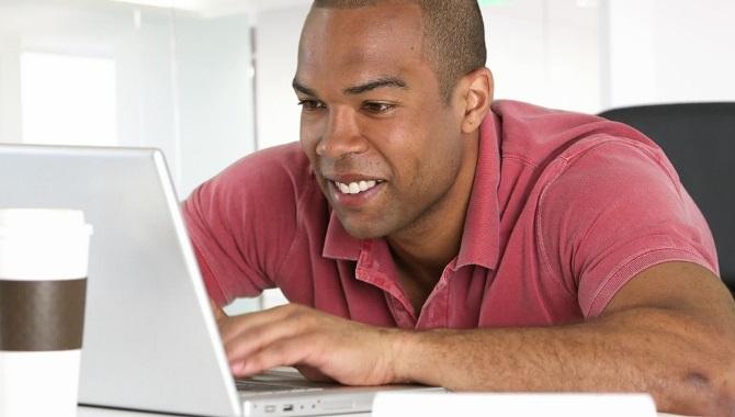Smiling On Laptop