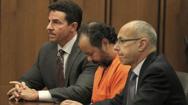Ariel Castro, 52, sits with his head down between his attorneys Jaye Schlachet and Craig Weintraub during his pre-trial hearing in Cleveland