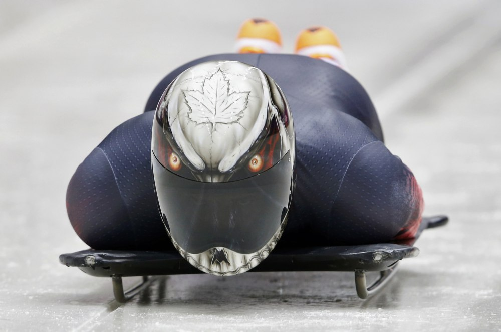 Canada's Neilson speeds down the track during a men's skeleton training session at the Sanki sliding center in Rosa Khutor, a venue for the Sochi 2014 Winter Olympics, near Sochi