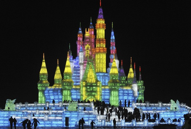 People visit an ice sculpture for the upcoming 25th Harbin International Ice and Snow Festival at a park in Harbin
