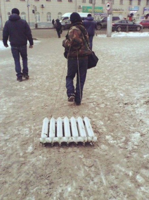 TheAwesome Photos From Russia With Love - bath radiator sledge