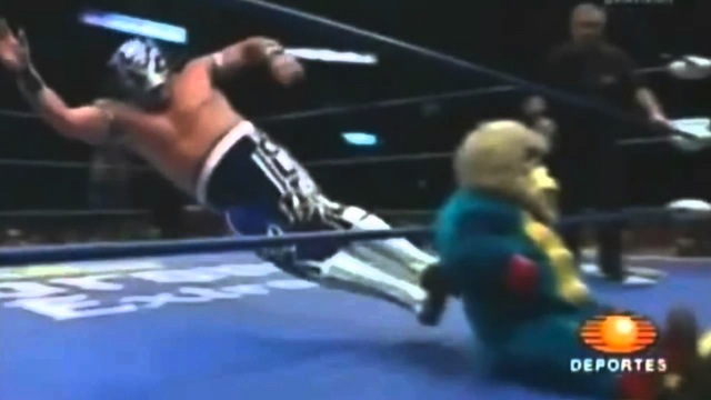 VIDEO: Mexican Wrestler Sends Midget In Monkey Costume