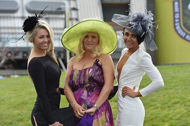 Pictured are mother and two daughters LtR: Georgia Newton, Paula Clarke and Katie Clarke at Ladies Day, Aintree Racecourse, The Crabbies Grand National