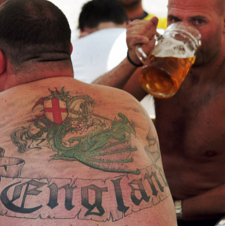ENGLAND FANS DRINK BEER ON A CAFE TERRACE AT FIGUEIRA SQUARE IN LISBON.