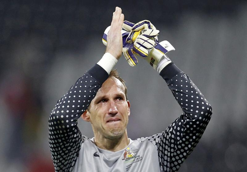 Australia's goalkeeper Schwarzer cries at the end of a 2010 World Cup Group D soccer match against Serbia at Mbombela stadium in Nelspruit