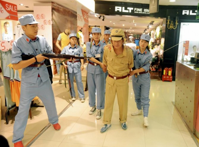 Chinese Mall Re-enact Executions - clothes sale