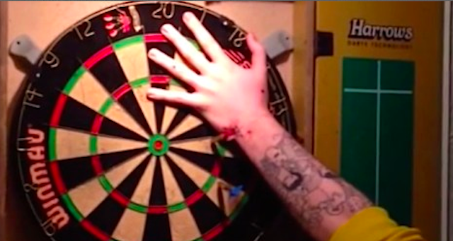 Drunk Scottish Guy Uses Hand As Dartboard