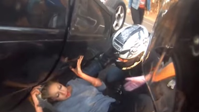 Biker Rescues Girl Flipped Car