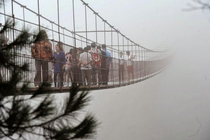 China - glass-bottomed suspension bridge in the mist 2