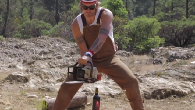 Man Opens Bottle With Chainsaw