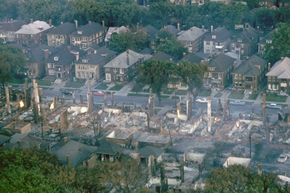 Smoldering ruins of middle class black neighborhoo