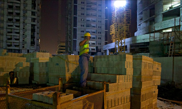 MDG : forced labour in Qatar : A North Korean worker on a construction site in Qatar
