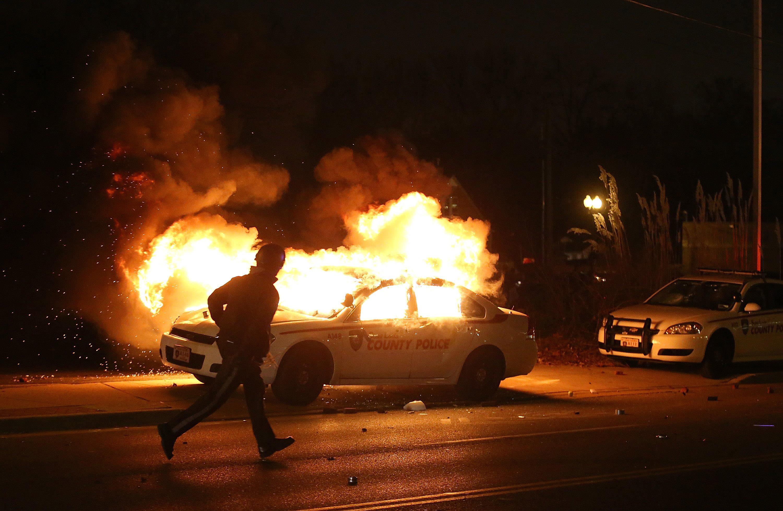 police car fires in ferguson