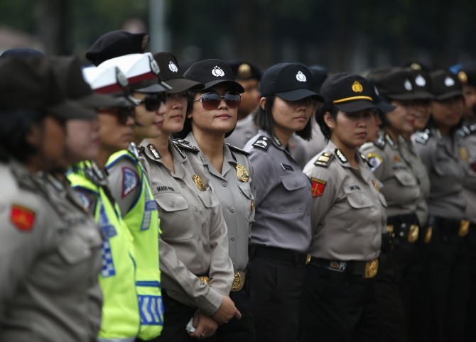 Indonesian police officers stand guard outside the presidential palace during a protest against the recent fuel price hike  in Jakarta