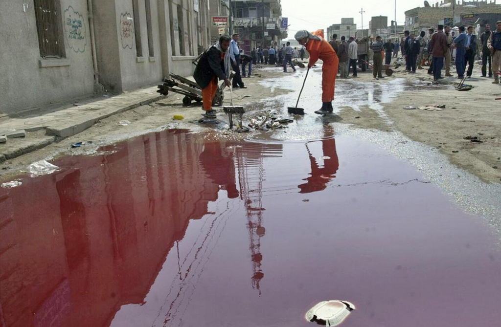 Iraq War In Pictures - Aftermath Of Suicide Bomb