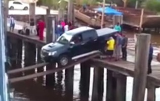 Car Attempts To Board Ship Via Planks