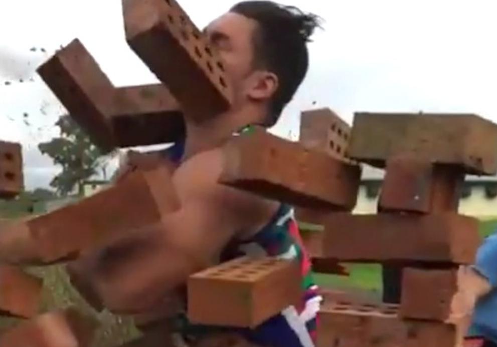 Rugby Player Runs Through Brick Wall