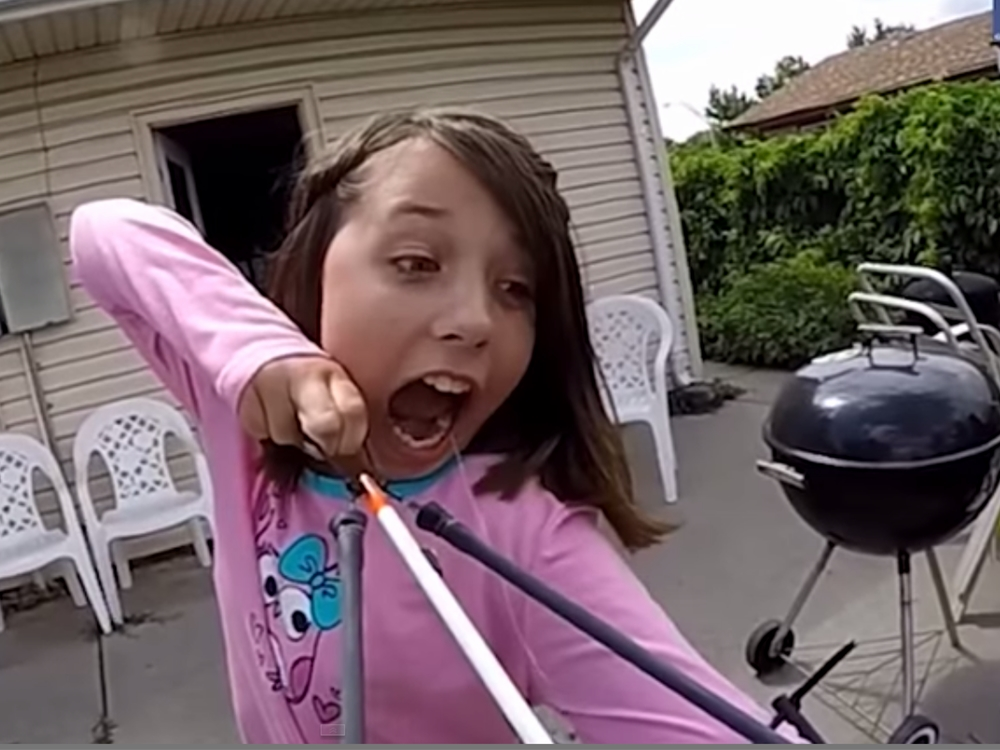 Girl Fires Tooth Out Of Mouth Bow And Arrow