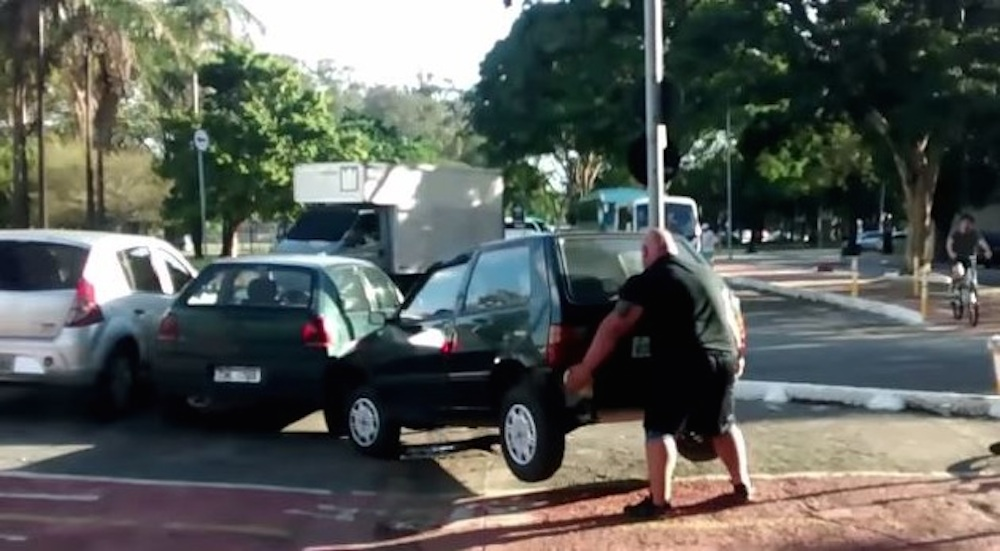 Insanely Strong Guy Lifts Car