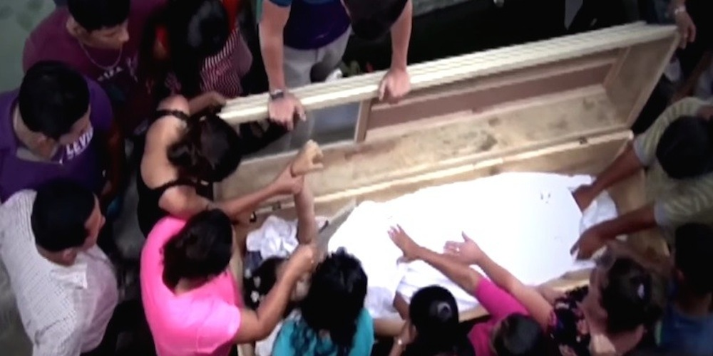 Family Unearth Coffin After Girl Screaming Inside