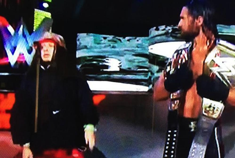 Fan Jumps Barrier With Seth Rollins