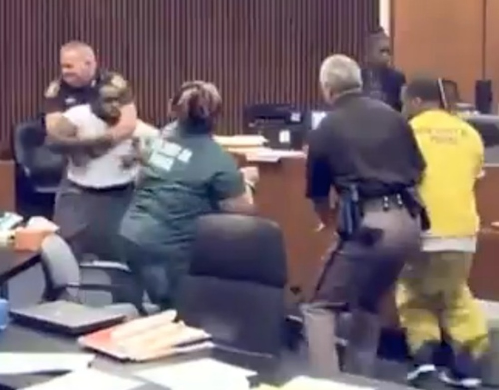 Father Punches Daughter's Killer Court