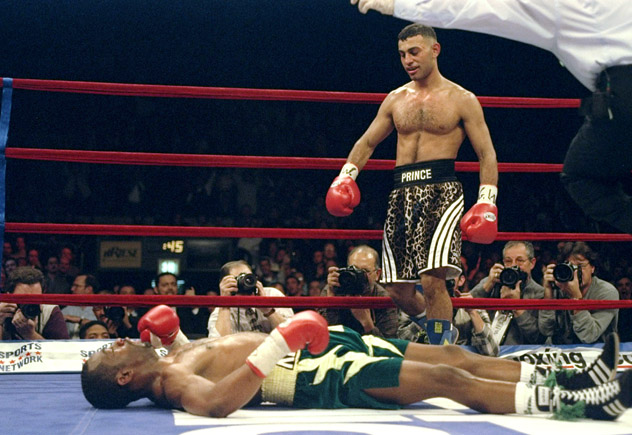 18 Dec 1997: Prince Naseem Hamed stands over Kevin Kelley during a fight at Madison Square Garden in New York City, New York. Hamed won the fight with a fourth round knockout. Mandatory Credit: Al Bello /Allsport
