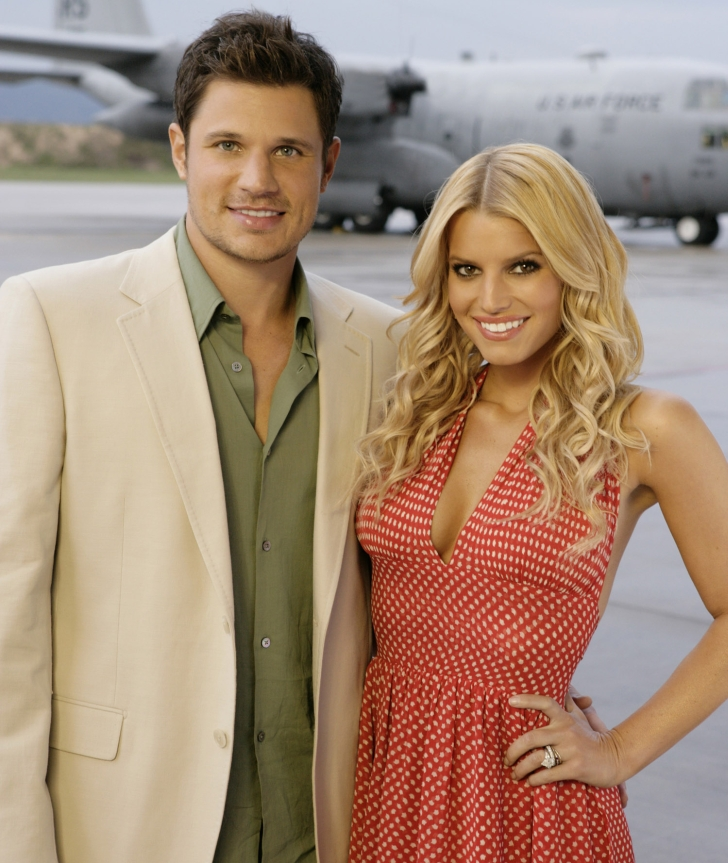 """102921_6400 -- NICK & JESSICA'S TOUR OF DUTY - America's favorite young married couple, Nick Lachey and Jessica Simpson, multi-platinum artists known from their hit MTV series """"Newlyweds,"""" take their variety show on the road to star in """"Nick & Jessica's Tour of Duty."""" In the vein of the popular Bob Hope classics, Nick and Jessica will travel overseas to bring a touch of home to our men and women in uniform. Like their previous specials, the duo will showcase their singing and comedic talents in musical performances with such guests as Willie Nelson, Big & Rich, Brian McKnight, Jimmy Kimmel and Drew Lachey, plus they'll be delivering some emotional surprises from home. """"Nick & Jessica's Tour of Duty"""" airs MONDAY, MAY 23 (9:00-11:00 p.m., ET), on the ABC Television Network. (ABC/CRAIG SJODIN) NICK LACHEY, JESSICA SIMPSON"""