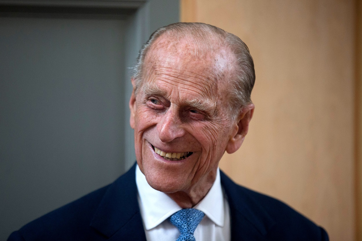 LONDON, ENGLAND - JUNE 8: Prince Philip, Duke of Edinburgh, smiles after unveiling a plaque at the end of his visit to Richmond Adult Community College in Richmond on June 8, 2015 in London, England. Prince Philip, officially opened and was shown round the new art, drama and dance facilities at the further education college which offers up to 2,000 courses. (Photo by Matt Dunham - WPA Pool / Getty Images)