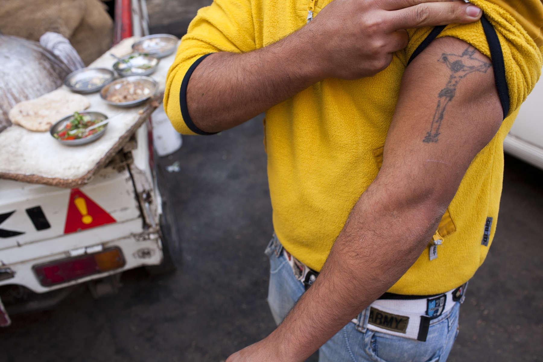 Zabaleen of Moqqatam - Jesus Tattoo