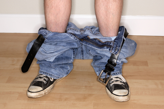 A5B6J5 Man with pants down around ankles