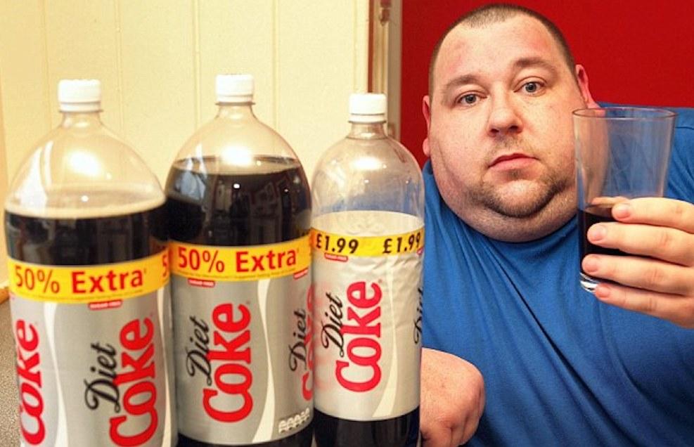 Fat man drinking Coke