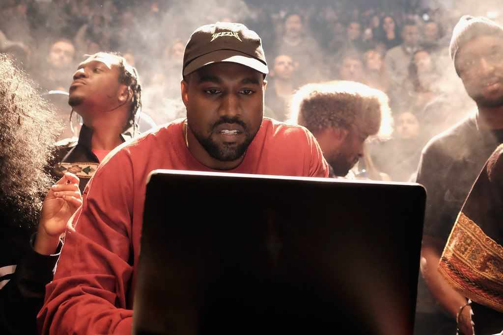 Kanye West with laptop