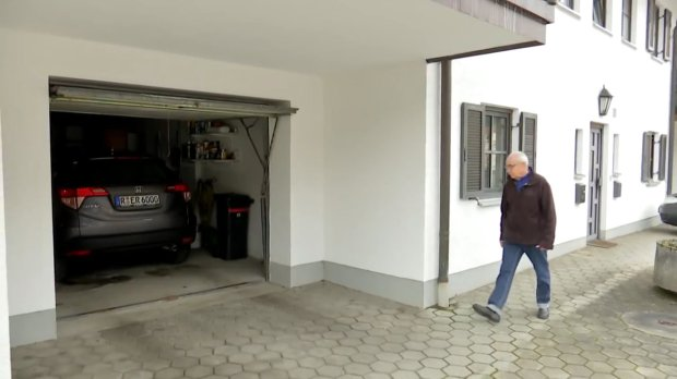 "Pic shows: the garage.nnA German motorist has offered a 1,000 EUR reward to try and find lovers who damaged the bodywork on his brand-new car and stained it with semen in a steamy sex session.nnErik Roschetsky was furious when he was left with a 3,000 EUR (2,322 GBP) repair bill after a randy couple had sex on his car - and also left behind sperm stains.nnHe said: ""There were footprints on the bodywork, there was bodily fluids running down to the bottom of the car, and it was only two days old.""nnHe had even taken the trouble to put the car in a garage to keep it off the streets during the Carnival festivities in Wörth an der Donau, a town in the district of Regensburg in Bavaria in Southern Germany, but drunken revellers but discovered he had not locked the door, and sneaked inside for a naughty number.nnWhen Erik returned the next day to use the vehicle, he was shocked to discover a huge dent in the bodywork. One of the wing mirrors had also been ripped off, and when he noticed suspicious stains on the bodywork he called police.nnDetectives then confirmed that the stains were semen, hardening the suspicion that the dent was caused by somebody using the car to have sex. Police believe one of the pair was probably holding onto the wing mirror when it snapped off.nnPolice confirmed that they have secured a DNA sample from the vehicle and are looking for the revellers, who they believe probably went into the underground car park looking for a quiet place to have sex.nnPolice spokesman Josef Schweiger said they were investigating on charges of trespassing and criminal damage.nnOutraged local Anna Stadler said: ""I am shocked that this can happen during a festival which is supposed to be a holy time, you'd think they could find somewhere more appropriate than sneaking into a garage.""nn(ends)nn          n"