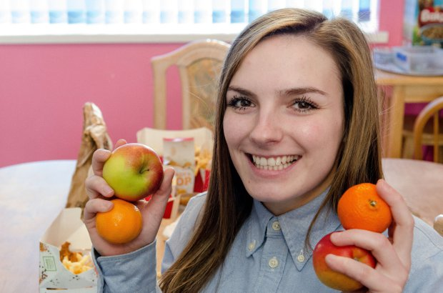 PIC BY JAMES NEWELL/MERCURY PRESS (PICTURED: GEORGIA SCOTNEY, 21, HOLDING FRUIT) A woman who ate KFC chicken and chips for THREE years straight because of an eating disorder is finally cured and can try other foods for the first time. Georgie Scotney, from Portsmouth, had Selective Eating Disorder from a young age and for as long as she can remember has only ever been able to eat chicken and chips because she was too afraid to try anything else. She would even go for days without eating if she was away on a school trip and for the past three years all the 21-year-old had been able to eat was KFC chicken strips or popcorn chicken with chips. SEE MERCURY COPY