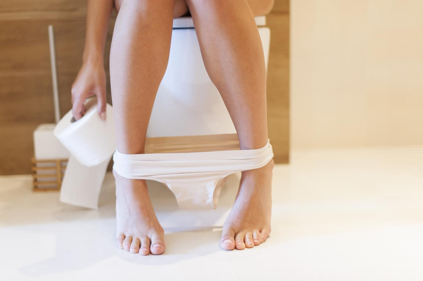Woman sat on toilet