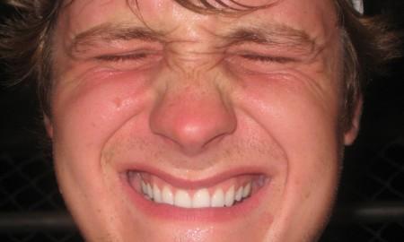 Man wincing Pain
