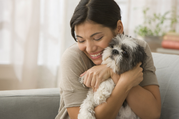 Young Woman hugging dog
