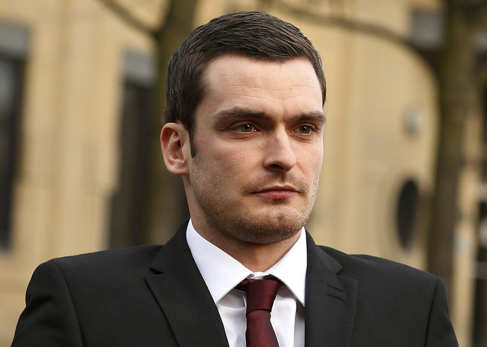Former Sunderland soccer player Adam Johnson leaves Bradford Crown Court in Bradford, northern England
