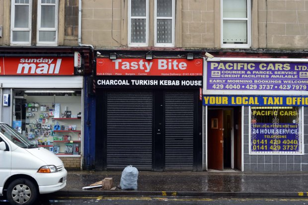 """GV showing Tasty Bite on Glasgow's Paisley Road West where 17 different takeaways have been hit with food hygiene warnings, MAY 02 2016 See SWNS story SWDIRTY; This city centre street could be the most dangerous place in Britain to get a takeaway - after 17 fast food joints were hit with food hygiene warnings. Environmental health chiefs have swooped on a series of Indian, Italian, Chinese and Turkish takeaways on Glasgow's Paisley Road West in the past year. Now the three-and-a-half mile stretch of road is in the running for the dubious honour of most risky place in Britain to buy a bag of chips. A dozen of the takeaways were slapped with """"improvement required"""" notices last year and a further five premises have had them issued so far this year."""